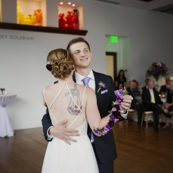 Bride and groom dance during their Uptown Charlotte wedding reception at Foundation for the Carolinas