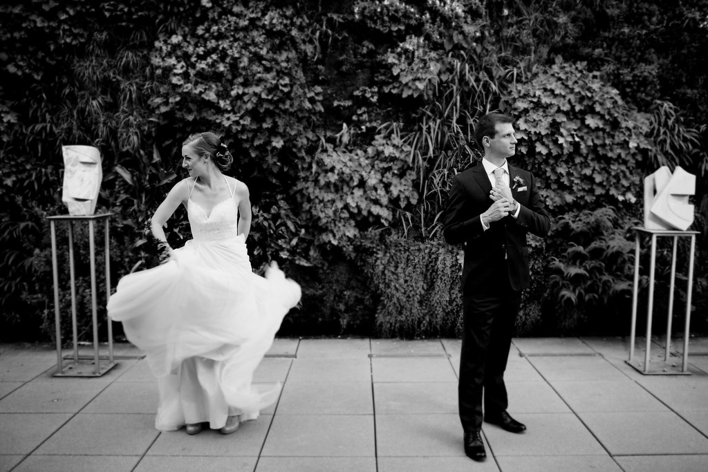Bride and groom posing before their wedding at Foundation for the Carolinas captured by Paper Hearts Photography