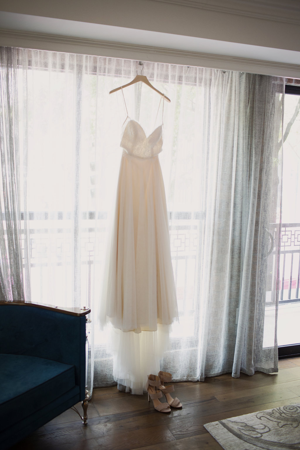 Detail shot of bridal gown captured by Paper Heart Studios for a Uptown Charlotte wedding