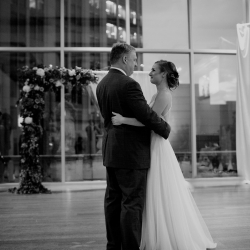 Bride dances with her father during her Uptown Charlotte wedding captured by Paper Heart Studios