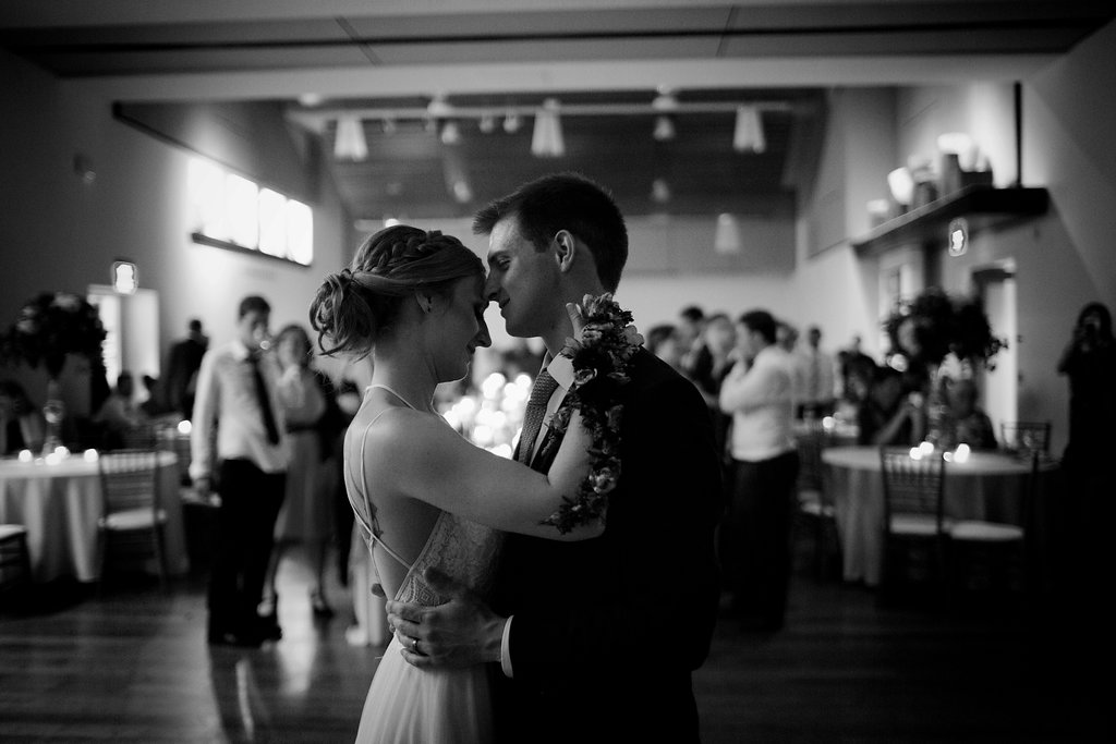 Bride and groom dance during their wedding reception at Foundation for the Carolinas captured by Paper Heart Studios