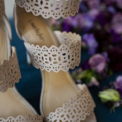 Detail shot of bridal shoes captured by Paper Heart Photography for a spring wedding at Foundation for the Carolinas