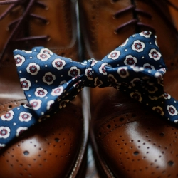 A floral bow ties is the perfect accessory for a groom getting married in Uptown Charlotte this summer