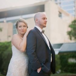 Bride and groom show off their serious side during their summer wedding for Paper Heart Photography