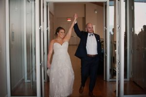 Bride and groom are all smiles as they are introduced into their reception all planned by Magnificent Moments Weddings