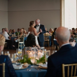 Bride and groom share a sweet first dance during their reception coordinated by by Magnificent Moments Weddings