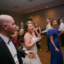 Bride and groom dance the night away to music by Hipshack band during their wedding reception coordinated by Magnificent Moments Weddings