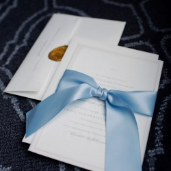 Stunning invitation suite is tied up with a blue stain ribbon the perfect touch for Paper Heart Photography