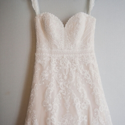 Custom hanger holds stunning lace wedding gown for a brides Charlotte Uptown wedding