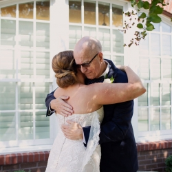 Bride and her father share a sweet moment during their very own first look coordinated by Magnificent Moments Weddings