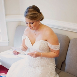 Bride reads a sweet note from her groom on her wedding day all captured by Paper Heart Photography