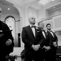 Groom anxiously awaits his bride during his wedding ceremony coordinated by Magnificent Moments Weddings