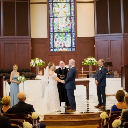 Bride and groom exchange vows during their wedding day coordinated by Magnificent Moments Weddings