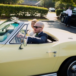 A vintage sports car is the perfect ride for a bride and groom who are marrying in Uptown Charlotte