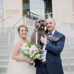 Bride, groom, and puppy are all smiles for Paper Heart Photography as they prepare for their wedding at The Mint Museum Uptown