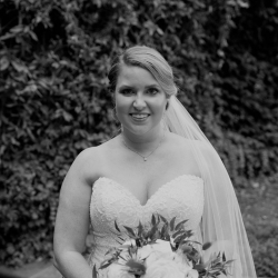 Bride holds her stunning bridal bouquet created by Magnificent Moments Weddings Florals for her summer wedding Uptown