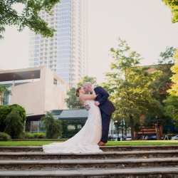 Bride and groom share a kiss at The Green in Uptown Charlotte as they prepare for their wedding captured by Paper Heart Photography