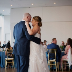 Bride and groom share a sweet first dance during their wedding reception coordinated by Magnificent Moments Weddings