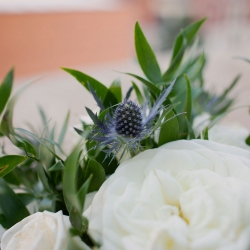 Touches of blue accent white centerpieces created by Magnificent Moments Weddings Florals for a summer wedding in Charlotte
