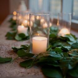 Greenery leaves and candle light provided the perfect setting for a romantic wedding at The Mint Museum Uptown
