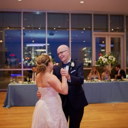 Bride shares a dance with her dad during her wedding reception in Uptown Charlotte coordinated by Magnificent Moments Weddings