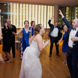 Bride and groom enjoying themselves on the dance floor to music from Hipshack Band during their Uptown Charlotte wedding