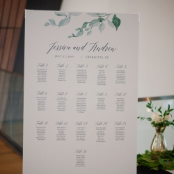 A seating chart with greenery accents was the prefect touch to a summer wedding at The Mint Museum Uptown