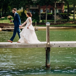 Rob + Kristen photography captures a bride and groom on Lake Norman during their boho fall wedding