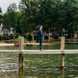 Groom awaits his bride during a first look captured by Rob + Kristen Photography