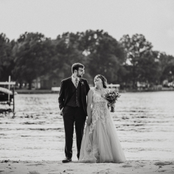 Bride and groom share a sweet look before their wedding ceremony on Lake Norman