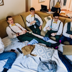 Groom and groomsmen get ready for a fall wedding captured by Rob + Kristen Photography