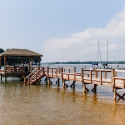 Stunning dock of Lake Norman served as the perfect photo setting for pictures during a fall wedding coordinated by Magnificent Moments Weddings