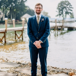 Groom is all smiles during his lake wedding coordinated by Magnificent Moments Weddings