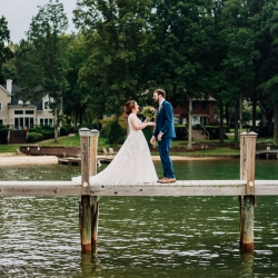 Bride and groom embrace after a first look during their fall wedding on Lake Norman