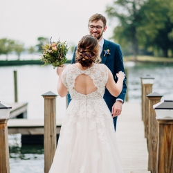 Bride shows off stunning lace details on her dress while sharing a first look with her groom captured by Rob + Kristen Photography