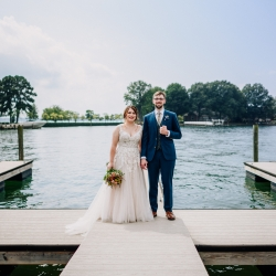 Bride and groom pose on Lake Norman during their fall wedding.