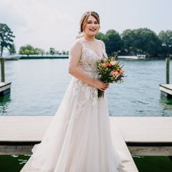 Rob + Kristen photography captures a bride on stunning Lake Norman during her wedding coordinated by Magnificent Moments Weddings