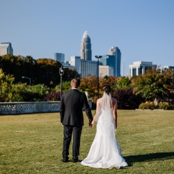 Rob and Kristen Photography capture a bride and groom during their fall wedding in Uptown Charlotte, North Carolina