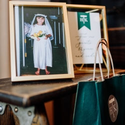 Childhood photographs of the bride and groom were featured throughout their fall wedding at Vivace in Uptown Charlotte captured by Rob and Kristen Photoraphy