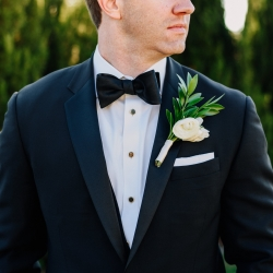 Rob and Kristen capture a detail show of the groom before his wedding ceremony wearing a simple white boutonniere created by Magnificent Moments Weddings