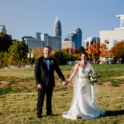 Rob and Kristen Photography capture the bride and groom in Uptown Charlotte showing off the city skyline in the background