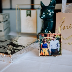 The gift table at a fall wedding at Vivace in Uptown Charlotte features fun pictures of the couple in vintage frames all captured by Rob and Kristen Photgraphy