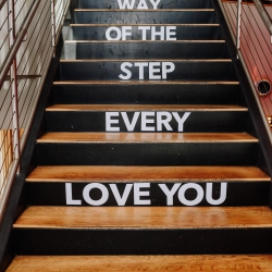 Rob and Kirsten capture a loving message on steps leading for a fall wedding at Vivace coordinated by Magnificent Moments Weddings