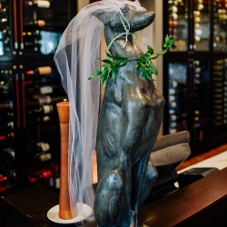Statue at Vivace in Uptown Charlotte dressed up for a fall wedding captured by Rob and Kristen Photography