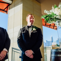 Groom anxiously awaits his bride during his wedding ceremony at Vivace in Uptown Charlotte all captured by Rob and Kirsten Photography
