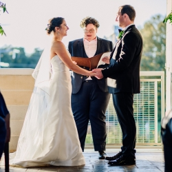Bride and groom exchange vows at Vivace in uptown Charlotte during their fall wedding captured by Rob and Kristen Photography and coordinated by Magnificent Moments Weddings