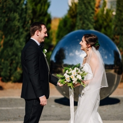 Bride and groom share a sweet first look captured by Rob and Kristen Photography for their uptown Charlotte wedding