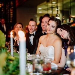 Bride shares a sweet moment with family during toasts at her Uptown Charlotte Wedding captured by Rob and Kristen Photography
