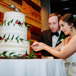 Bride and groom cut their simple cake by Honey Butter Bakery during their wedding at Vivace in Uptown Charlotte