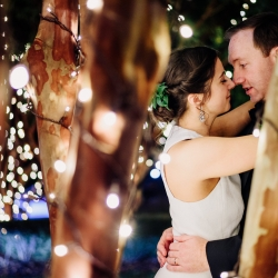 Rob and Kristen Photography capture a bride and groom in the night lights of uptown Charlotte during their fall wedding coordinated by Magnificent Moments Weddings